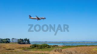 Jetstar airplane is landing at the Auckland Airport