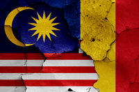flags of Malaysia and Romania painted on cracked wall