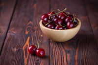Cherry in a wooden bowl