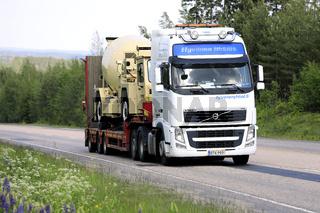 White Volvo FH Truck Hauls Concrete Transporter
