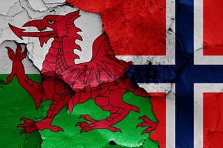flags of Wales and Norway painted on cracked wall
