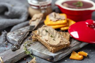 Chicken liver pate on a slice of whole-grain bread.