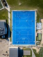 Top down view of blue soccer field