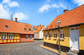 Street with yellow buildings and cooblestone