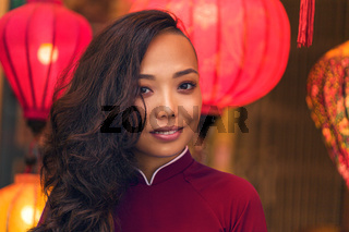 Portrait of young asian woman in traditional vietnamese dress ao dai in Vietnam