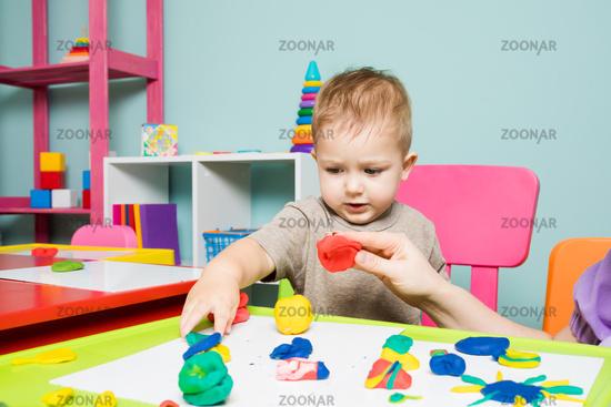 The baby boy develops creativity in the children's center