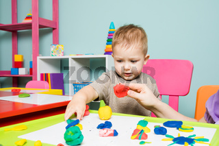 The baby boy develops creativity in the children's center