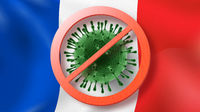 Warning sign with crossed out Coronavirus molecule on the background of French flag.