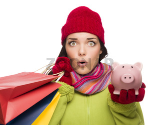 Concerned Mixed Race Woman Holding Shopping Bags and Piggybank