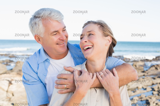 Happy casual couple by the coast