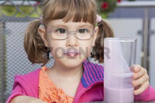 Little girl enjoying its milkshake