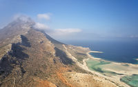 Aerial view on Platiskinos mountain range and Balos lagoon with sandy beach. Crete, Greece.