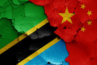 flags of Tanzania and China painted on cracked wall