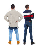 Back view two man in sweater.
