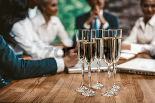 Wineglasses With Champagne at Business Meeting