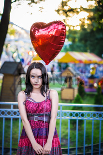 Young woman with balloon