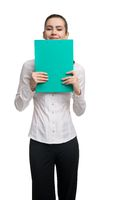 Cheerful businesswoman with clipboard smiling at camera