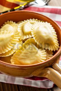 Italian stuffed pasta. Panzerotti pasta in bowl