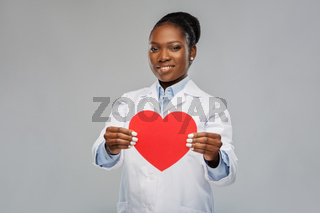 african american female doctor with red heart