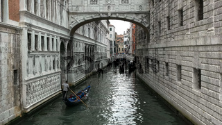 gondolas navigating a narrow canal in venice