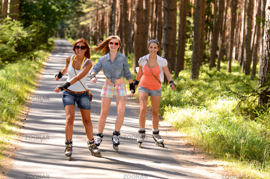 Three friends on in-line skates outdoor