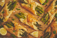Grilled green asparagus and cheese puff pastry folded as envelope and topped with black sesame