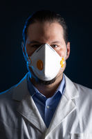 Medical doctor wearing a respiratory mask. Blue light emergency and medicine crisis concept.