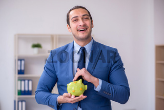 Young male employee in budget planning concept