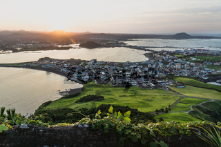 Last orange lightbeam sunset view from Ilchulbong peak to Seongsan, Jeju Island, South Korea