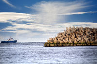 breakwater around sea port is made of concrete tetrapods