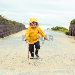 Little boy playing with wood stick