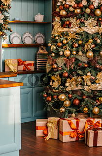 Gift boxes and golden Christmas tree, wrapped presents and decor in country style as holiday home decoration