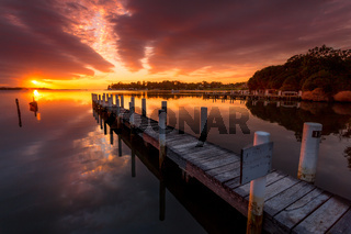 Jetty with views to sunrise sky