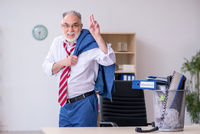 Old businessman employee rejecting new ideas with lots of papers