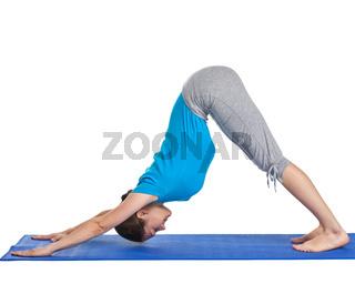 Yoga - young beautiful woman yoga instructor doing downward facing dog pose (adho mukha svanasana) exercise isolated on white background