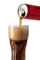 pouring cola soda drink from can to glass