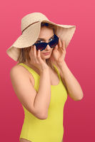 Attractive chic young woman in summer outfit