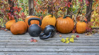 pumpkins and kettlebells in backyard
