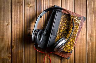 headphones with antique books