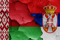 flags of Belarus and Serbia painted on cracked wall