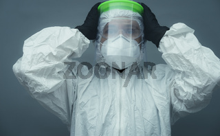 Covid19, Nurse with protective face mask, glasses and sanitary mask. coronavirus and treatment concept on gray and neutral background