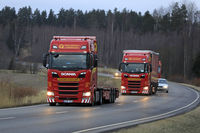 Red Next Generation Scania Trucks on Highway
