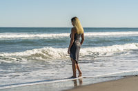 Beautiful Blonde Model Poses On A Beach Alone