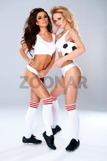 Two sexy seductive female athletes