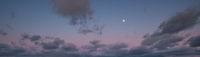 Clouds and full Moon in twilight sky view. Panoramic night sky background.
