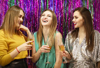 Smiling women proposing toast during party