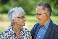 Retired couple smiling in love
