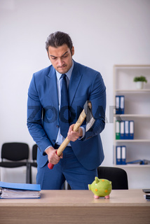 Aggressive male employee with hatchet in budget planning concept