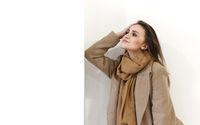 Joyful lady in fashionable coat