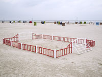 Fenced-in beach ball court